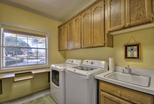 Traditional Laundry Room with Built-in bookshelf, double-hung window, Carpet, Crown molding, laundry sink, Standard height