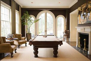 Traditional Game Room with French doors, Hardwood floors, Cement fireplace, Crown molding, Arched window