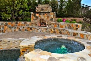 Rustic Hot Tub with Outdoor floor lanterns, stone fireplace, exterior stone floors, Raised beds