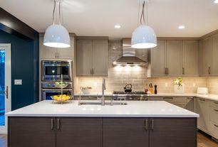 Contemporary Kitchen with Pendant light, Kitchen island, Stone Tile, Undermount sink, French doors, European Cabinets, Flush