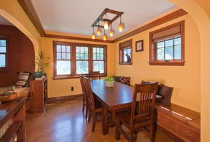 Traditional Dining Room with Built-in bookshelf, Concrete floors, Pendant light, Crown molding