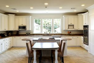 Traditional Kitchen with Subway Tile, Complex granite counters, Raised panel, Crown molding, Undermount sink, Kitchen island