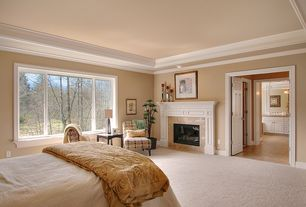 Traditional Master Bedroom with stone fireplace, Luxor Matelasse Coverlet / Sham, Carpet, Crown molding, French doors