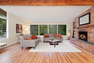 Eclectic Living Room with Exposed beam, interior brick, Hardwood floors