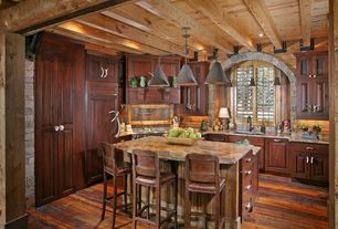 Rustic Kitchen with Breakfast bar, One-wall, Framed Partial Panel, Raised panel, can lights, Pendant light, Exposed beam