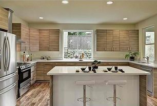 Contemporary Kitchen with Corian counters, Breakfast bar, Kitchen island, Flush, U-shaped, European Cabinets