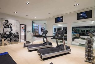 Modern Home Gym with can lights, Carpet, Standard height, X-mark vertical dumbbell rack, Life fitness club series treadmill