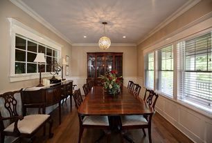 Traditional Dining Room with can lights, Standard height, double-hung window, Hardwood floors, Pendant light, Crown molding