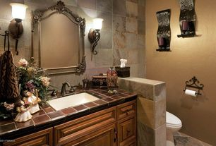 Eclectic Powder Room with Powder room, Flush, Howard Elliott 56004 Cortland Arched Antique Gold Leaf Mirror, Wall sconce