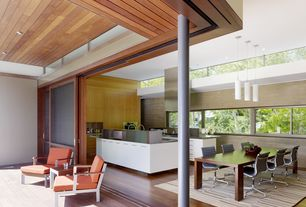 Contemporary Great Room with Mapp table, large, Cosmopolitan armchair, Pendant light, High ceiling, Hardwood floors