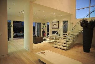 Contemporary room with Laminate floors, Cathedral ceiling