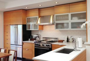 Contemporary Kitchen with Subway Tile, Glass panel, European Cabinets, Undermount sink, L-shaped, Corian counters, Flush