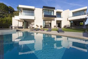 Modern Swimming Pool with sliding glass door, exterior concrete tile floors, picture window, Raised beds, Pool with hot tub