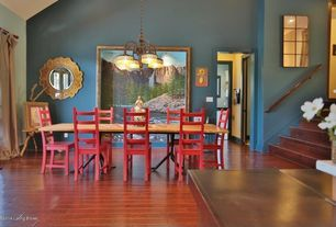 Eclectic Dining Room with Chandelier, Hardwood floors, High ceiling