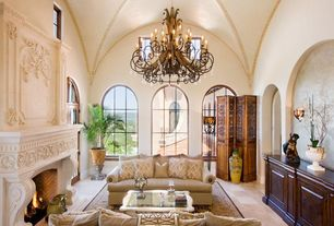 Mediterranean Living Room with Arched window, High ceiling, sandstone tile floors, French doors, Crown molding, Chandelier
