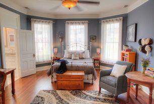 Traditional Master Bedroom with Hardwood floors, specialty door, Ceiling fan, Crown molding