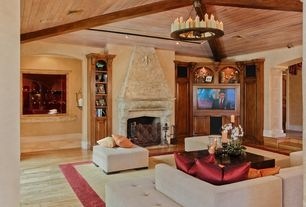 Mediterranean Living Room with Exposed beam, metal fireplace, Chandelier, Hardwood floors, Built-in bookshelf