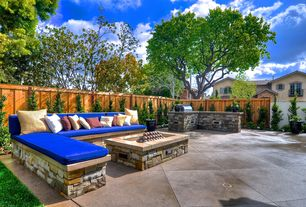 Traditional Patio with Fence, French doors, Fire pit, Outdoor kitchen, exterior tile floors