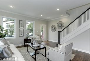 Traditional Living Room with can lights, Crown molding, double-hung window, Hardwood floors, Paint, French doors