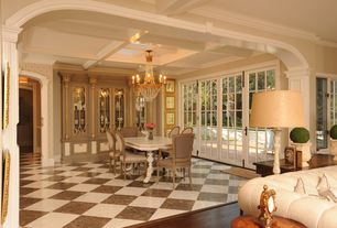 Traditional Dining Room with interior wallpaper, sandstone tile floors, French doors, Built-in bookshelf, Chandelier