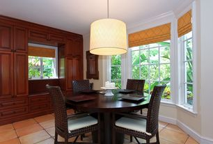 Tropical Dining Room with Pendant light, sandstone tile floors, Window seat, Crown molding