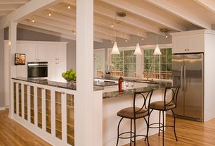 Traditional Kitchen with French doors, U-shaped, 3 in. Quartz Countertop in Shadow, Built In Refrigerator, Breakfast bar