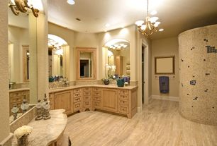 Mediterranean Master Bathroom with Glass panel, Master bathroom, Inset cabinets, Ceramic Tile, Wall sconce, Raised panel