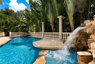 Traditional Swimming Pool with Fence, Pool with hot tub, exterior stone floors, Pathway