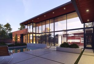 Contemporary Swimming Pool with Fence, Pathway, sliding glass door, picture window, Raised beds, Lap pool
