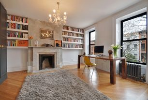 Eclectic Home Office with Standard height, stone fireplace, Chandelier, Built-in bookshelf, Fireplace, Hardwood floors