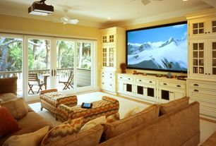 Traditional Home Theater with Crown molding, Paint 2, can lights, Standard height, Built-in bookshelf, sliding glass door