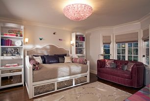 Eclectic Kids Bedroom with Paint 1, Hardwood floors, Crown molding, Wall sconce, Built-in bookshelf, Compact Loveseat