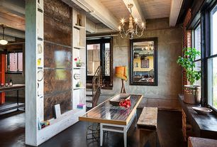 Eclectic Dining Room with Concrete floors, High ceiling, double-hung window, Built-in bookshelf, Chandelier, Exposed beam