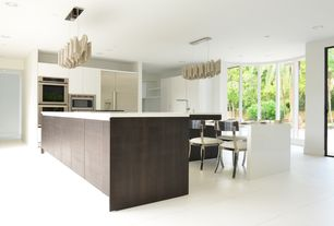 Contemporary Kitchen with limestone tile floors, Kitchen island, Pendant light, European Cabinets, Corian counters, L-shaped