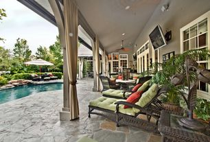 Tropical Porch with French doors, exterior stone floors, Pathway, Fountain, Wrap around porch, Transom window