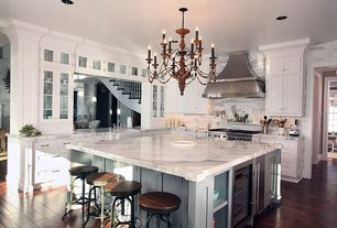 Traditional Kitchen with Glass panel, Ms international calacatta classic marble, Complex marble counters, Chandelier, Flush