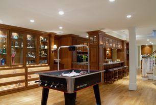 Traditional Game Room with Crown molding, Hardwood floors, Columns, Built-in bookshelf