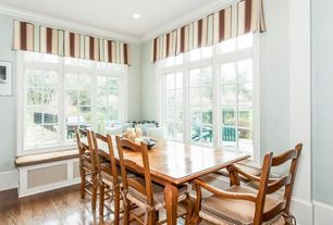 Traditional Dining Room with Casement, Window seat, can lights, Hardwood floors, Paint, Hardwood flooring, Crown molding