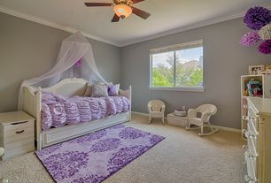 Traditional Kids Bedroom with Built-in bookshelf, Ceiling fan, Carpet, Crown molding