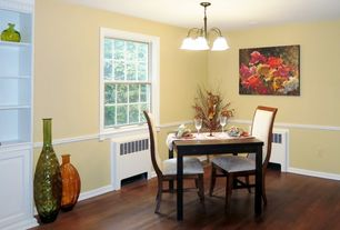 Traditional Dining Room with Built-in bookshelf, Chandelier, Hardwood floors, Chair rail