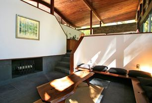 Contemporary Living Room with High ceiling, soapstone tile floors, Exposed beam, Sunken living room