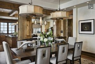 Rustic Dining Room with can lights, Exposed beam, Hardwood floors, Columns, flush light, Standard height