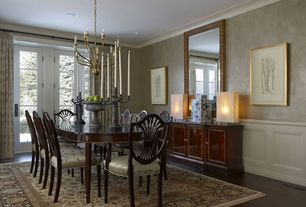 Traditional Dining Room with Standard height, interior wallpaper, Chandelier, French doors, can lights, Hardwood floors