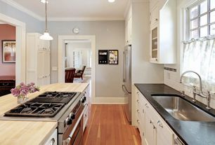 Traditional Kitchen with Inset cabinets, Pendant light, Tainless steel parq deck-mount kitchen bridge faucet, Wood counters