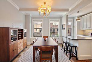 Contemporary Dining Room with Hardwood floors, Crown molding, Chandelier, Pendant light, Built-in bookshelf, Exposed beam