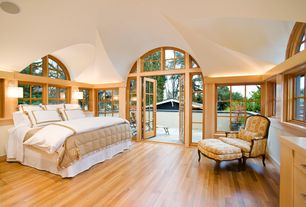 Contemporary Master Bedroom with Transom window, Armstrong maple natural hardwood, Wall sconce, Arched window, picture window
