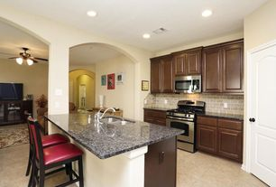 Traditional Kitchen with Inset cabinets, Stainless undermount 2-basin sink, Limestone Tile, Complex granite counters