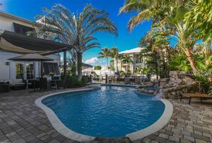 Mediterranean Swimming Pool with exterior stone floors, French doors, Raised beds, Pool with hot tub, Trellis