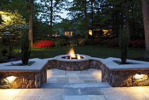 Traditional Patio with Natural stone retaining wall, exterior stone floors, Pathway, Fire pit, Raised beds