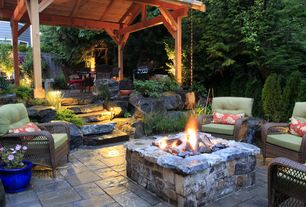 Rustic Patio with exterior stone floors, Outdoor kitchen, Fire pit, Fence, Pathway